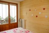 clairlune3-chambre2-vacances-riffroids-laclusaz
